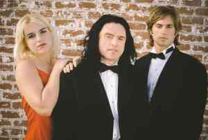Juliette Danielle, Tommy Wiseau, and Greg Sestero in The Room