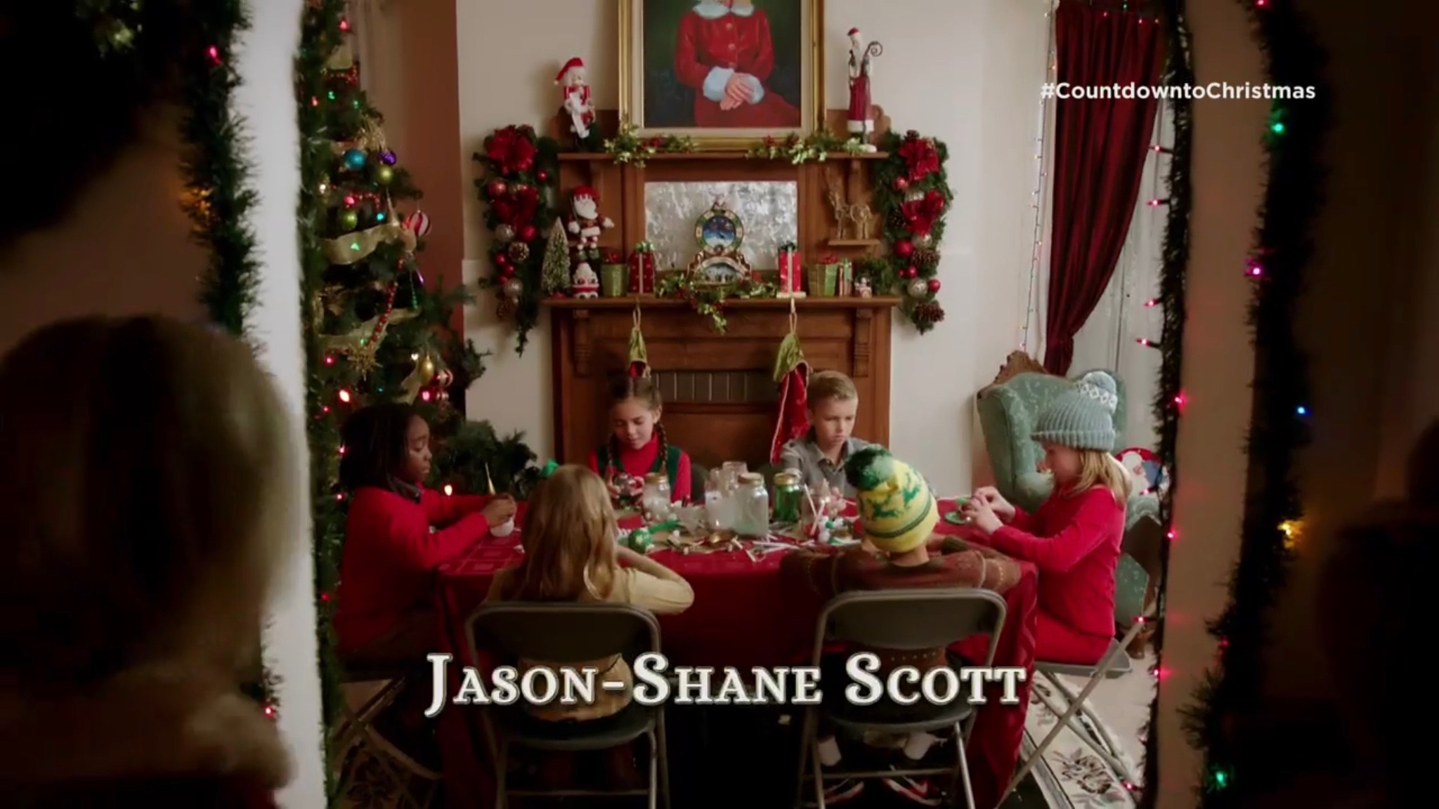 inside there are six kids sitting at a table when a woman played by maureen mccormick of brady bunch fame walks in with a picture of herself looking down on - When Is Christmas In 2015