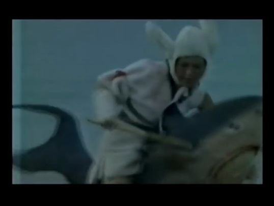 Right now a woman is riding a shark while wearing a bunny suit. (Zodiac Fighters, 1978)