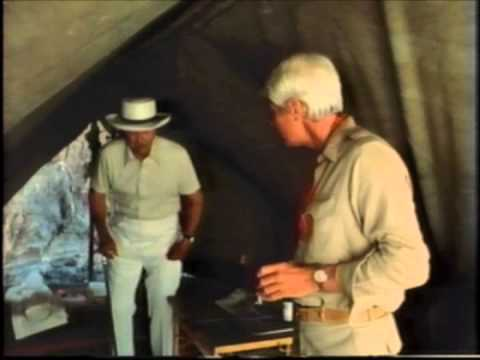 Dangerous international drug smugglers Ray Milland and Peter Graves